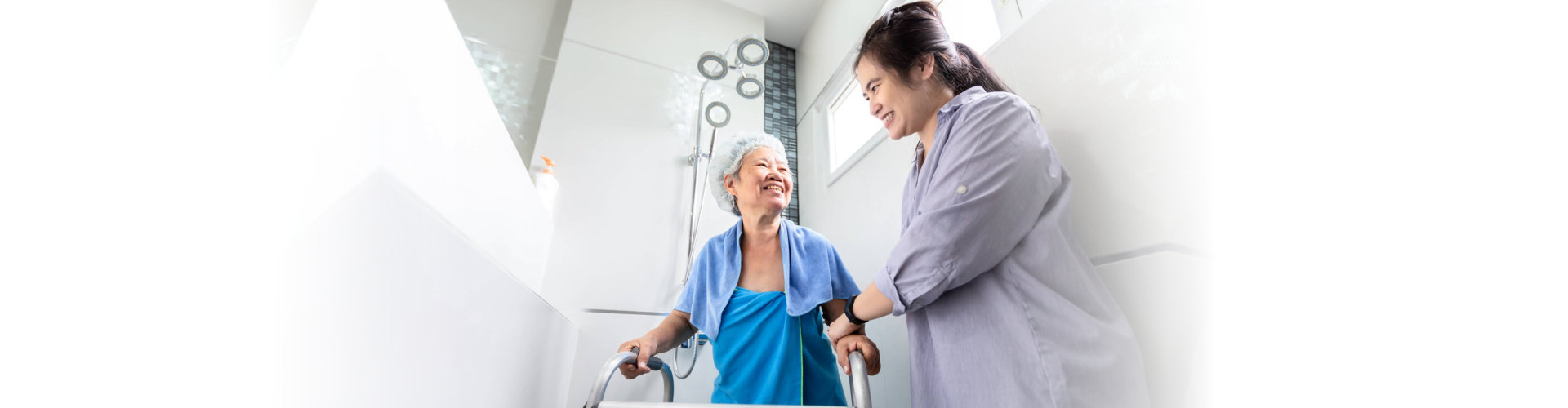 caregiver assisting an old lady